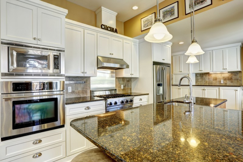 White lacquer cabinets by Masters Contracting Services